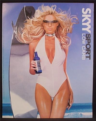 Magazine Ad For Skyy Sport Vodka, Sexy Woman in White Bathing Suit, Silver Surfboard, 2004