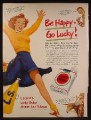 Magazine Ad For Lucky Strike Cigarettes, Cheerleader in Orange & Blue Uniform, 1950
