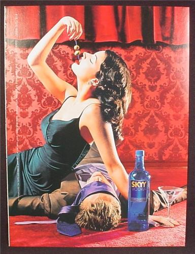 Magazine Ad For Skyy Vodka, #18 She Wins, Sexy Woman With Passed Out Man, 1999