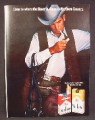 Magazine Ad For Marlboro Cigarettes, Cowboy In Leather Vest, Horse Tack on Arm, 1970
