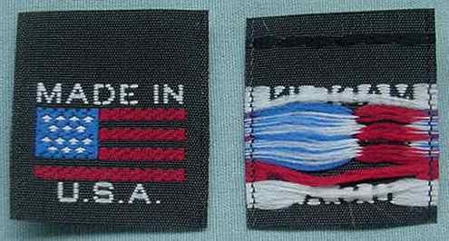 BLACK and WHITE AMERICAN FLAG - MADE IN U.S.A. BLACK WITH WHITE LETTERING, FLAG IS RED AND BLUE